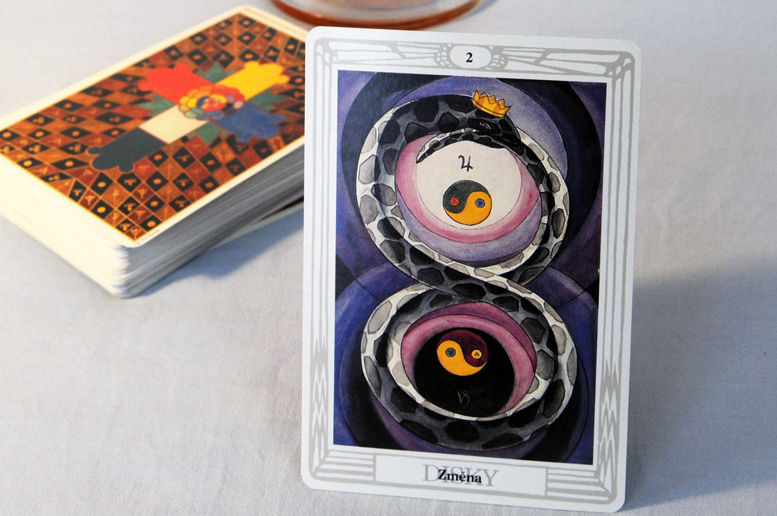 Tarot card Two of Disks